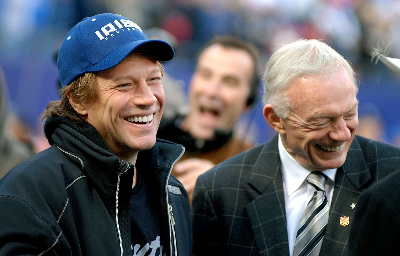 "Jon Bon Jovi shares a laugh with Jerry Jones before the New York Giants game against the Dallas Cowboys at Giants Stadium in East Rutherford, NJ.  In 2014, the Cowboys owner said of the rock star, ""I don't know of anyone that I have more respect for as a father or as a husband or, certainly, as a potential business partner. ... He's qualified to become an NFL owner."" ""He knows many of the owners personally. All owners know of him,"" Jones said of Bon Jovi. ""But he knows them personally. He's committed, he's very genuine. You talk about individuals and talk about their qualification -- there hasn't been anybody more qualified to be involved in sports ownership, or certainly ownership in the NFL, than Jon Bon Jovi."""