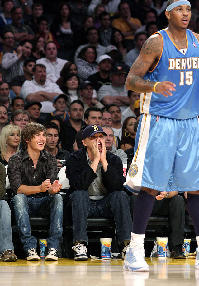 Zac Efron smiles as Leonardo DiCaprio heckles Carmelo Anthony during the Los Angeles Lakers game against the Denver Nuggets at Staples Center in Los Angeles.
