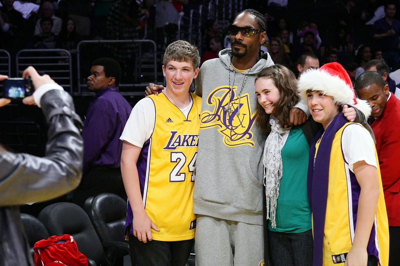 Snoop Dogg poses with fans during the Los Angeles Lakers game against the Boston Celtics on Dec. 25, 2008 at Staples Center in Los Angeles.