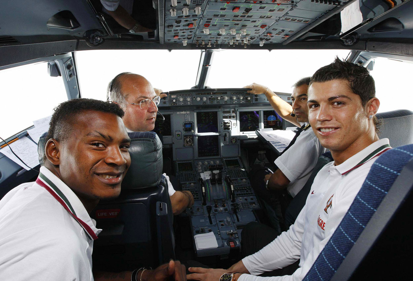 Cristiano Ronaldo and Portuguese national teammate Aziza Makukula pose in a cockpit on their way to Zurich.