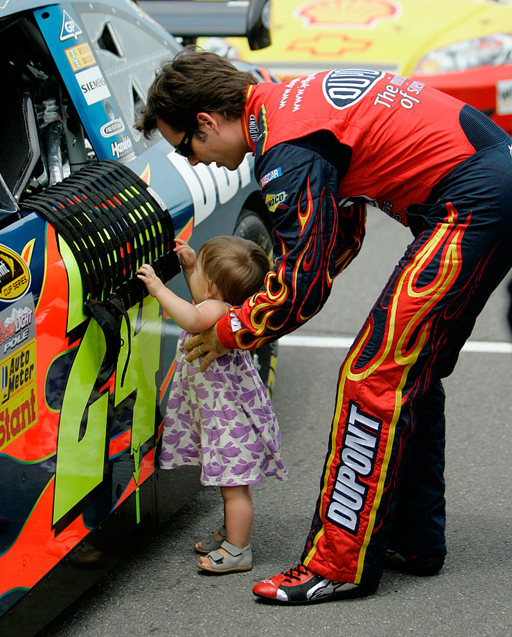 Jeff Gordon holds his daughter Ella Sofia along his car before the start of the LifeLock 400 at Michigan International Speedway.