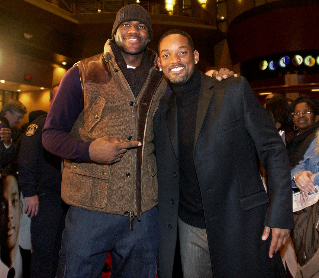 Will Smith poses LeBron James while arriving at a screening of his movie Seven Pounds in Valley View, Ohio.