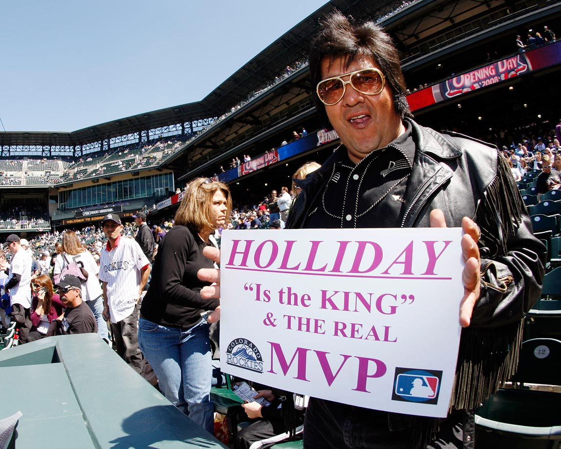 A Rockies and Elvis fan holds up a sign in support of outfielder Matt Holliday before the Colorado Rockies Opening Day game against the Arizona Diamondbacks at Coors Field in Denver on April 4, 2008.