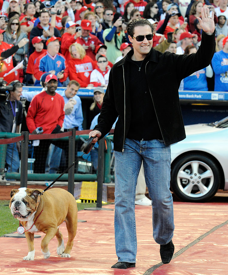 Pat Burrell and his dog Elvis arrive at a victory rally to celebrate the Phillies 2008 World Series championship.