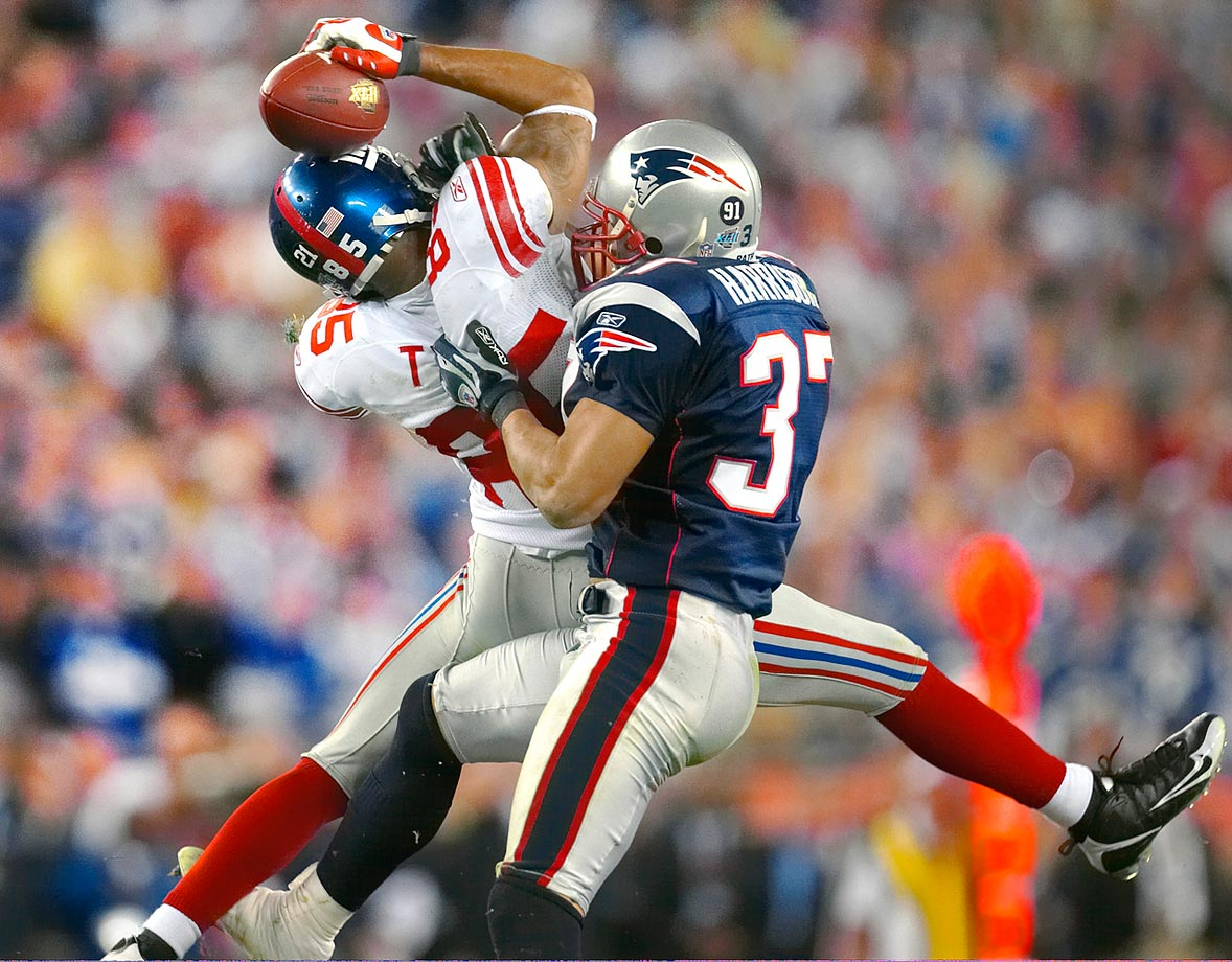 Giants wideout David Tyree secures a catch with his helmet against Patriots safety Rodney Harrison in Super Bowl XLII.