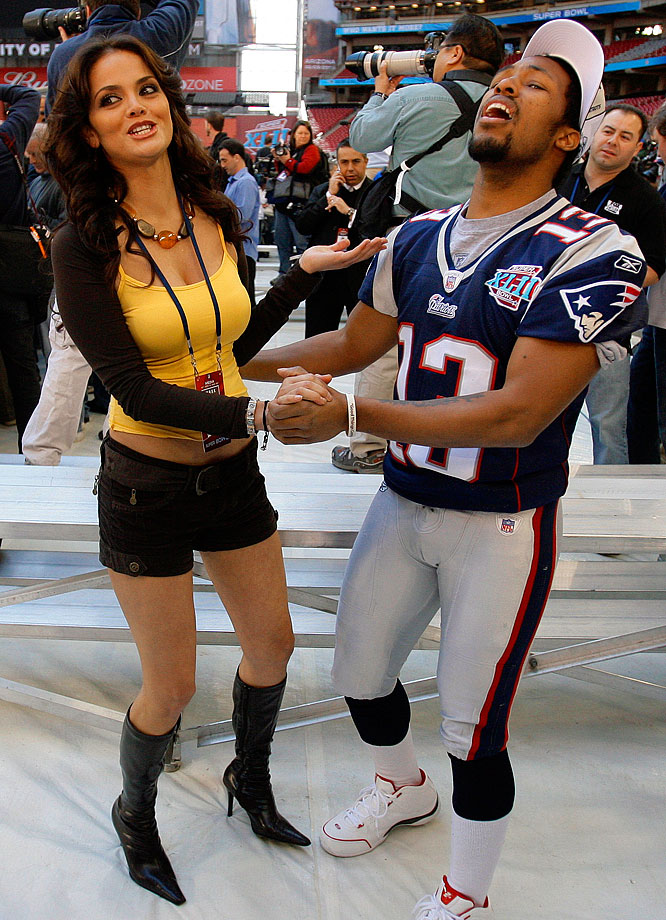 Patriots receiver Bam Childress dances a few steps with reporter Marisol Gonzalez during Super Bowl XLII Media Day.