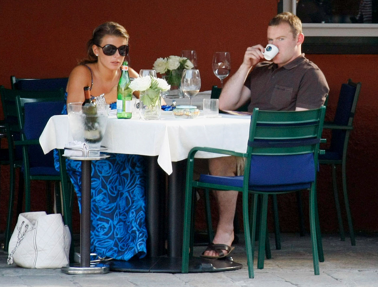 Rooney and fiancee Coleen eat at a restaurant in the main square of Portofino on June 9, 2008 during a trip to Italy.