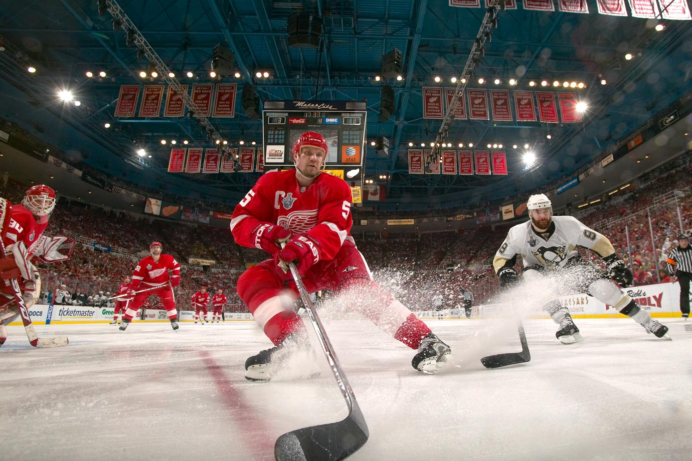Holding a 3-1 series lead, defenseman Nicklas Lidstrom (center) and the Red Wings had a chance to put the Penguins away at home in Game 5, but a last-minute, tying goal by Pittsburgh winger Max Talbot pushed the game into overtime, where the Wings finally fell in a third extra session.
