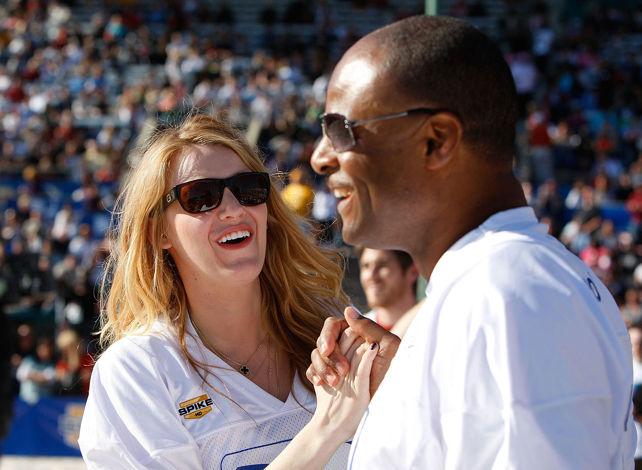 Blake Lively and Warren Moon celebrate during the 3rd Annual DirecTV Celebrity Beach Bowl on Jan. 31, 2009 in St. Petersburg, Fla.