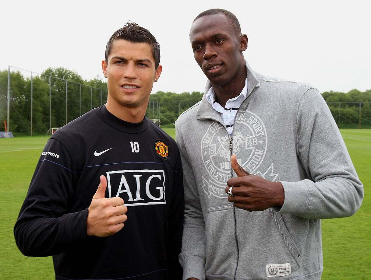 Usain Bolt poses with Manchester United star Cristiano Ronaldo ahead of a First Team training session at Carrington Training Ground in Manchester, England. Ronaldo left United to join Spanish side Real Madrid later in 2009.