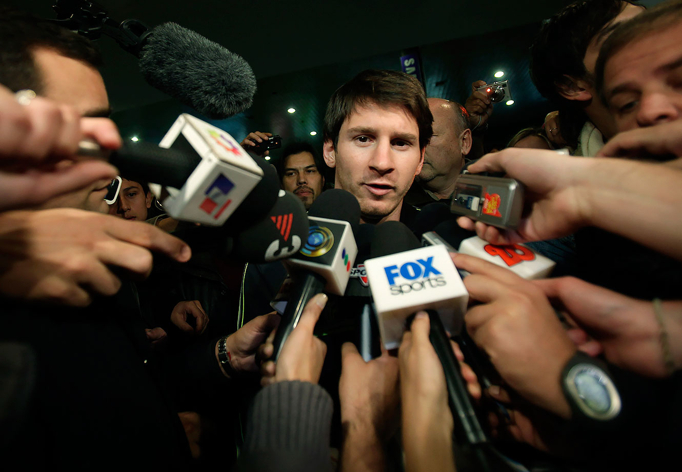 Lionel Messi speaks with the media upon his arrival at the Buenos Aires International Airport on May 30, 2009.
