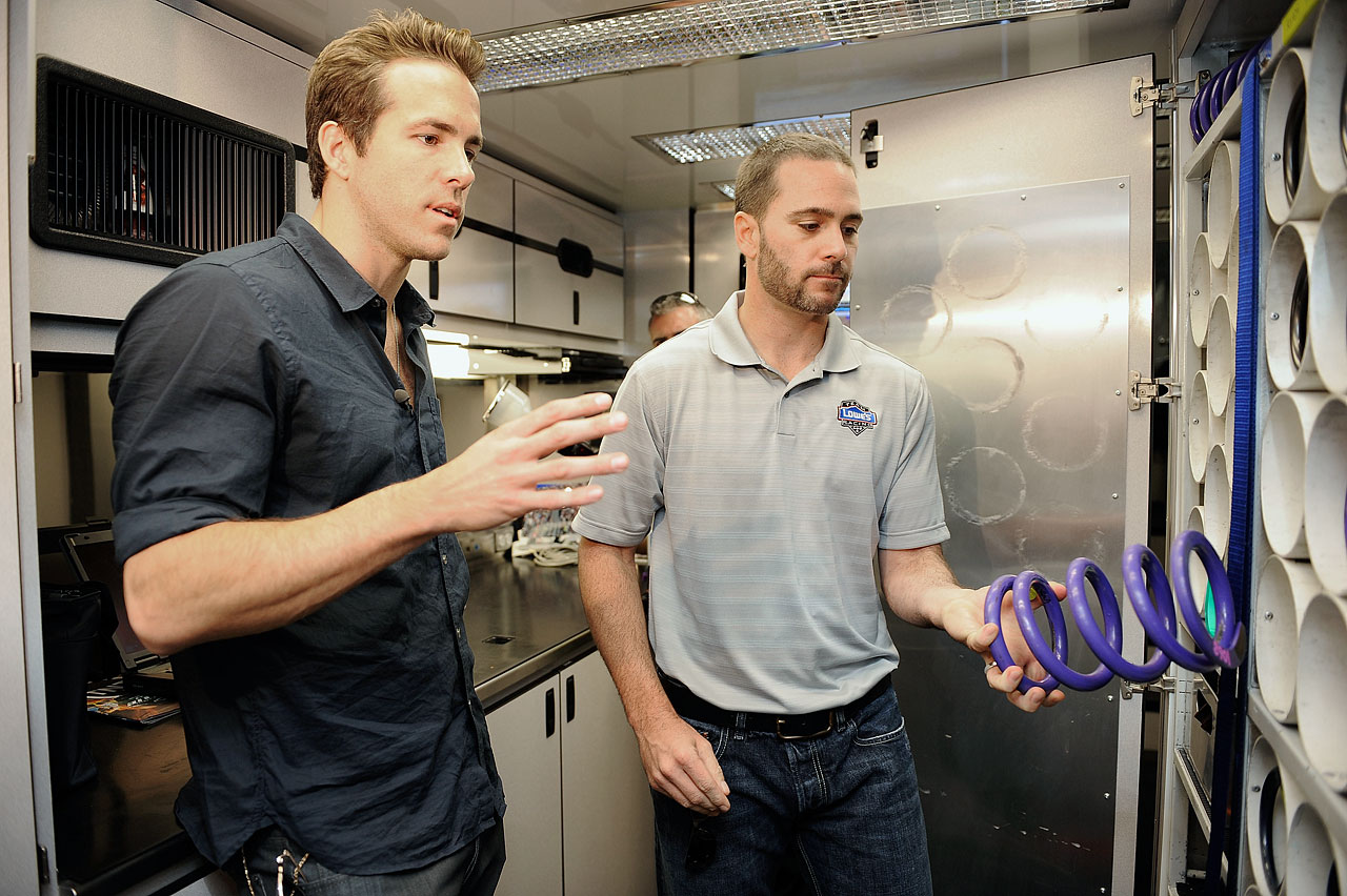 Ryan Reynolds talks with Jimmie Johnson in Johnson's hauler prior to the NASCAR Sprint Cup Series Pocono 500 on June 7, 2009 at Pocono Raceway in Long Pond, Penn.