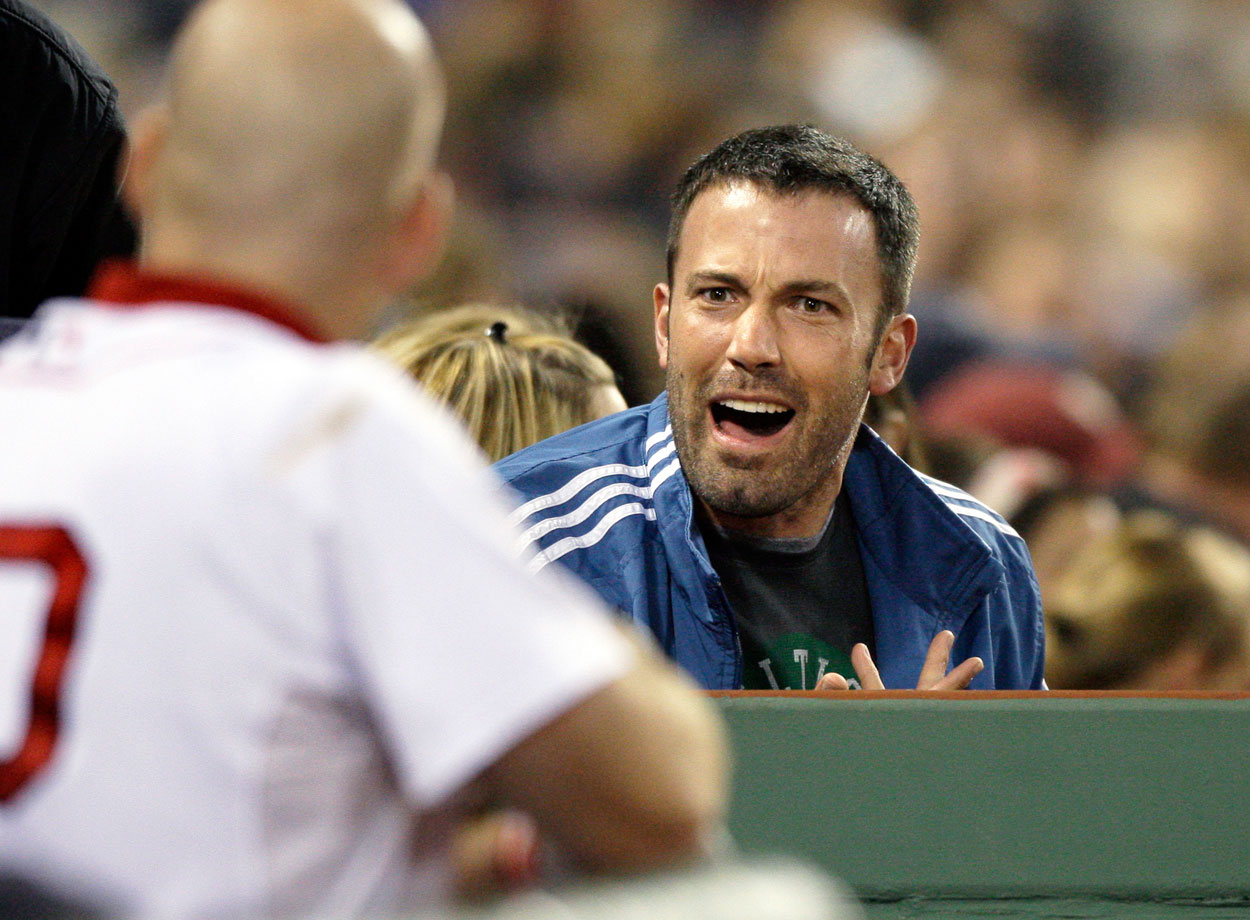 Ben Affleck talks to players in the Boston Red Sox dugout during their game against the Florida Marlins on June 16, 2009 at Fenway Park in Boston.
