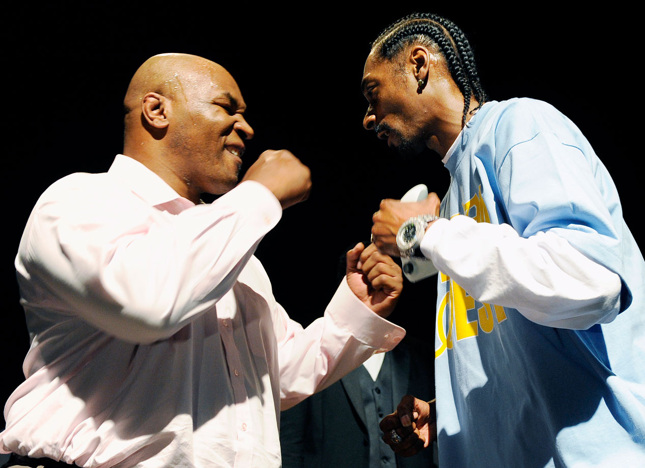 Mike Tyson and Snoop Dogg square off before playing each other in the new boxing video game Fight Night Round 4 on June 22, 2009 in West Hollywood, Calif.