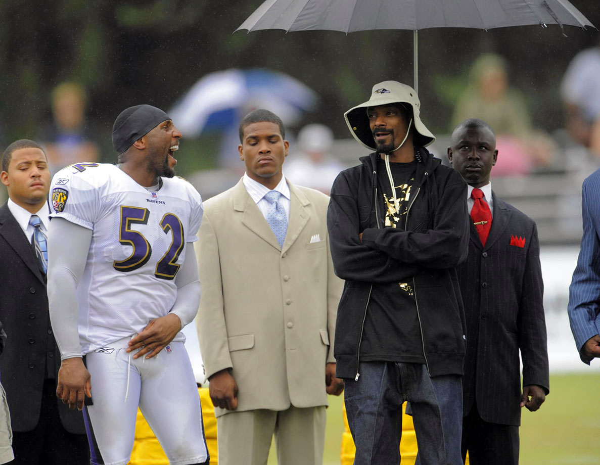 Ray Lewis laughs with Snoop Dogg on the sidelines during the Baltimore Ravens preseason practice on Aug. 6, 2009 at McDaniel College in Baltimore.