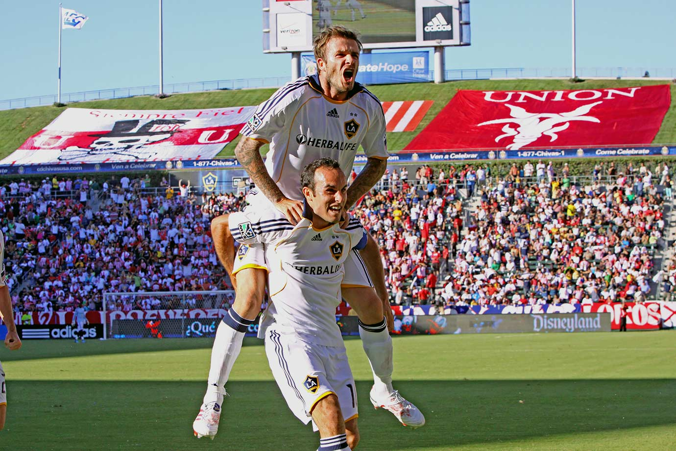 Landon Donovan and David Beckham of the Los Angeles Galaxy celebrate scoring a goal against Chivas USA during Game One of the MLS Western Conference Semifinals at The Home Depot Center in Carson, Calif.