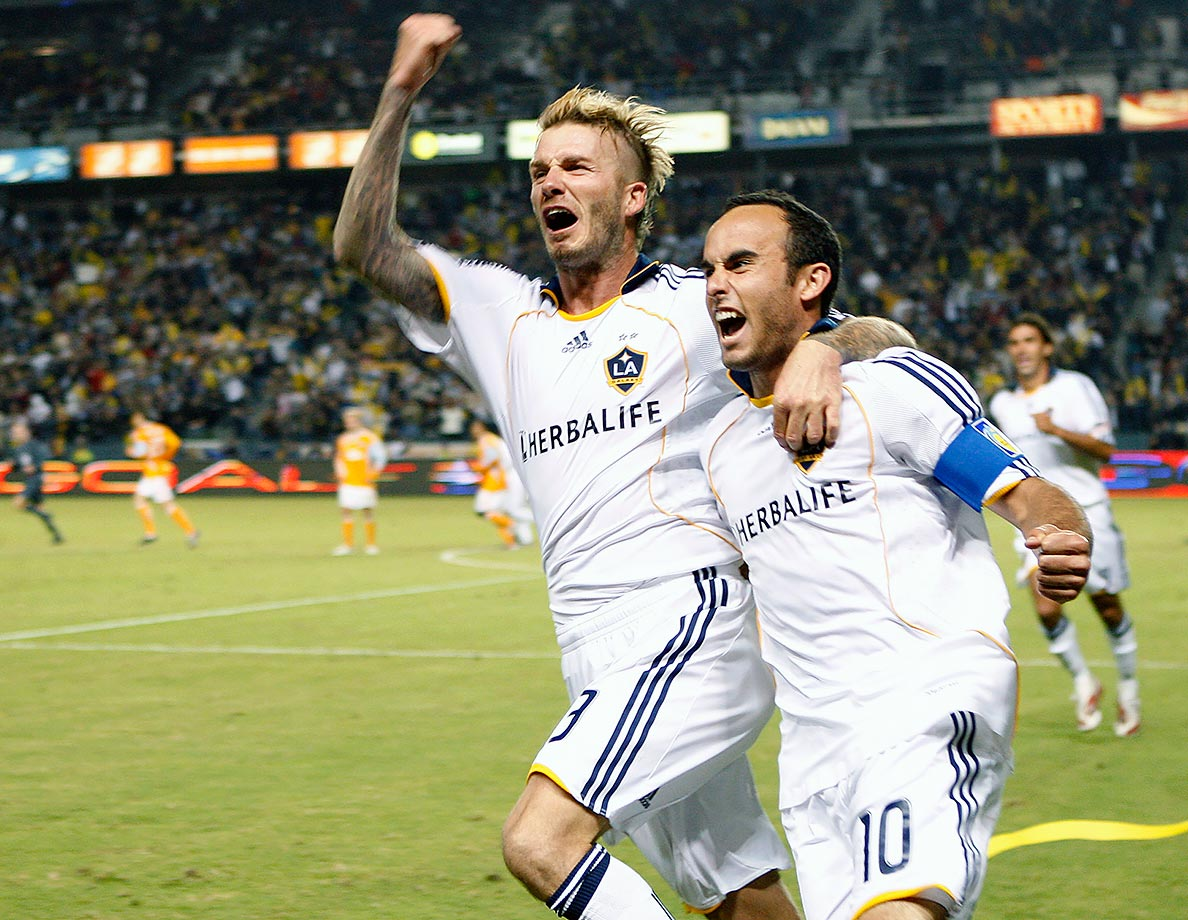 David Beckham and Landon Donovan celebrate the latter's goal against the Houston Dynamo during the 2009 MLS Western Conference Championship game at The Home Depot Center in Carson, Calif. The Galaxy won 2-0.