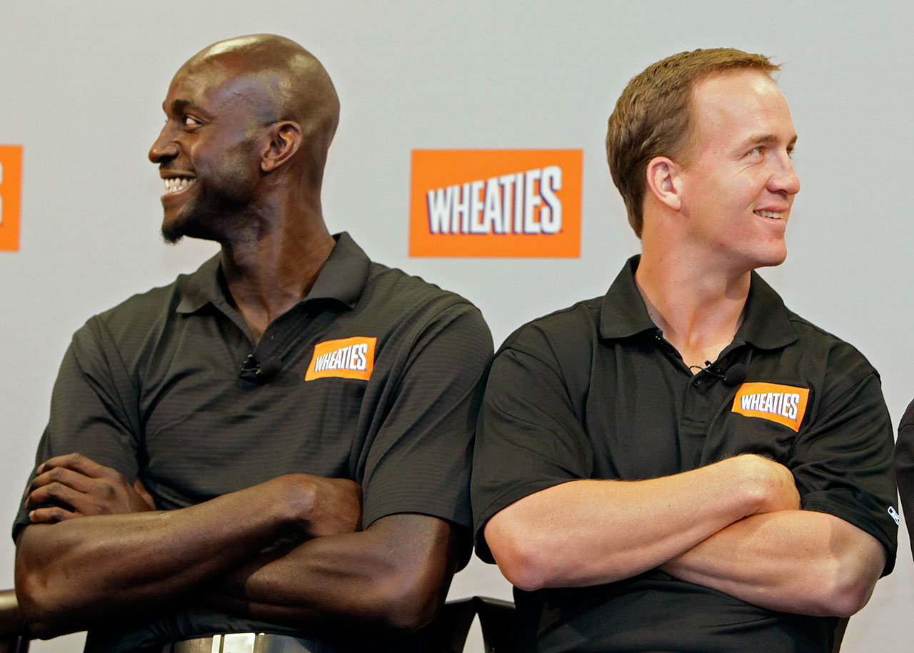 Kevin Garnett poses with then-Indianapolis Colts quarterback Peyton Manning during a promotional press conference for Wheaties.
