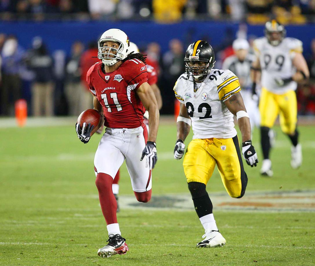 Larry Fitzgerald breaks away for a touchdown after a fourth-quarter reception behind James Harrison (92).