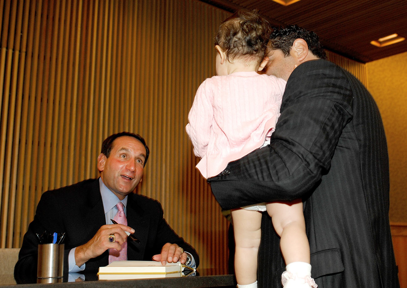 "Mike Krzyzewski greets fans during a book signing for ""The Gold Standard: Building a World-Class Team"" at Barnes & Noble in New York City in 2009."