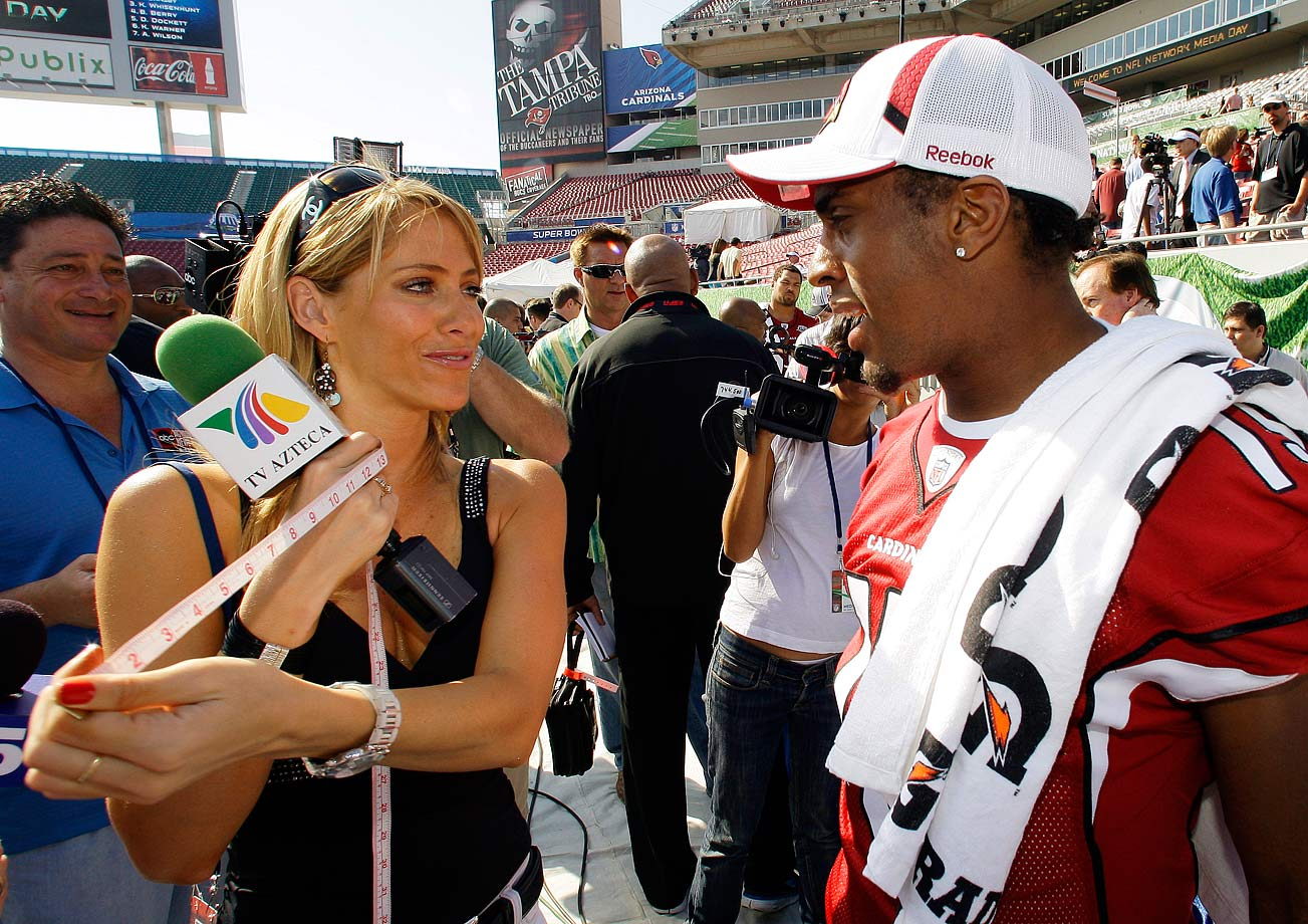 TV Azteca reporter Ines Sainz measures the bicep of Arizona Cardinals wide receiver Steve Breaston during Super Bowl XLIII Media Day.