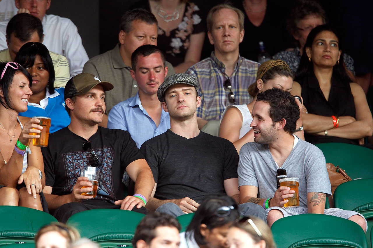 Justin Timberlake looks on during the Wimbledon men's third round match between Andy Roddick and Jurgen Melzer at All England Club in London on June 27, 2009.