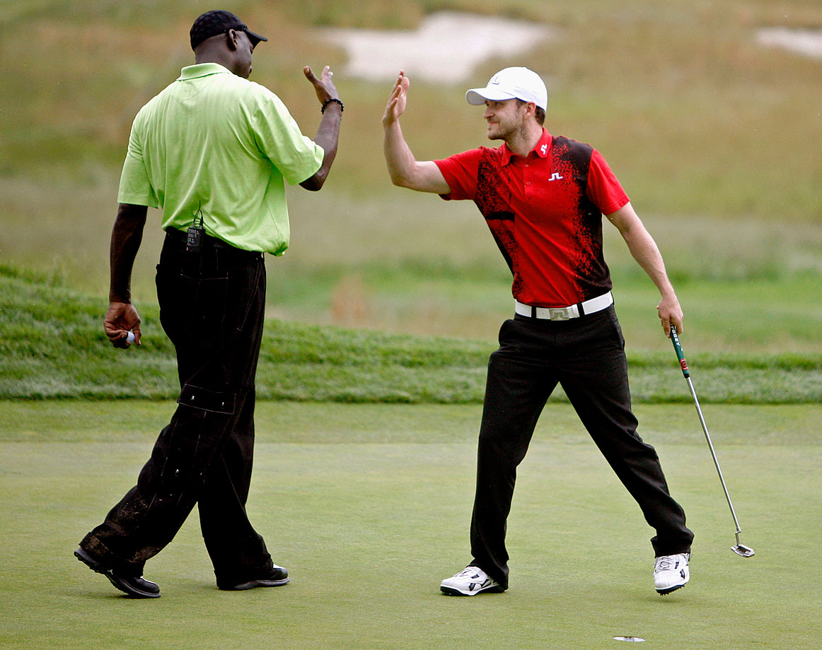 Michael Jordan and Justin Timberlake congratulate one another after finishing the Golf Digest U.S. Open Challenge on Bethpage State Park's Black Course in Farmingdale, NY, on June 12, 2009.