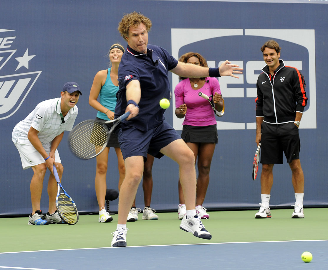 Will Ferrell hits forehands as Andy Roddick, Maria Sharapova, Serena Williams and Roger Federer look on and laugh during the Arthur Ashe Kids Day on Aug. 29, 2009 at the USTA Billie Jean King National Tennis Center in Flushing, N.Y.