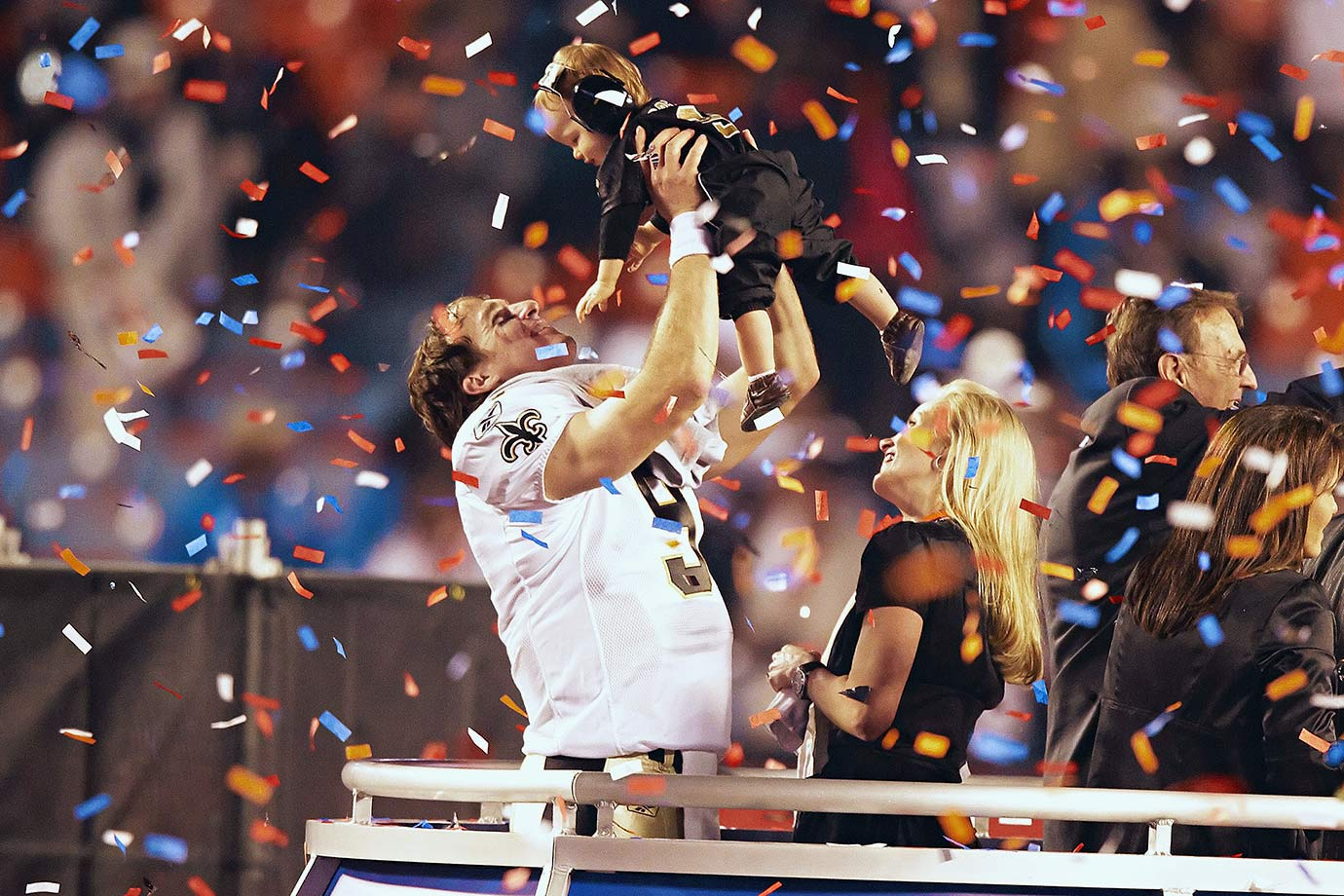 New Orleans Saints quarterback Drew Brees holds up his son Baylen as his wife Brittany looks on after the Saints' 31-17 win over the Indianapolis Colts. The victory was the first Super Bowl title for New Orleans and came just four years after Hurricane Katrina decimated the city and forced the Saints out of the Superdome for a year.