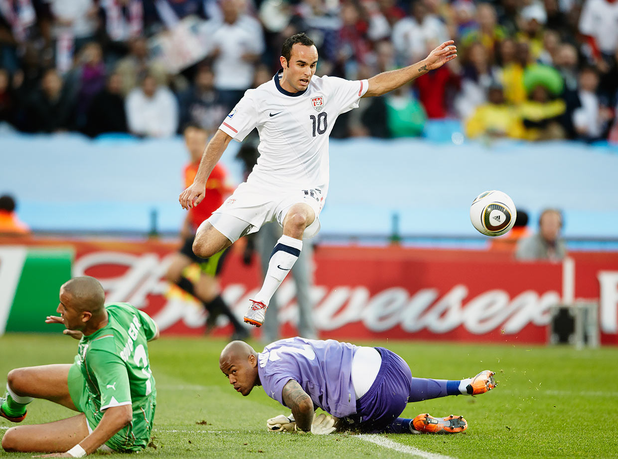 Landon Donovan jumps over the goalkeeper in the U.S. final group stage game against Algeria at the 2010 World Cup in South Africa.