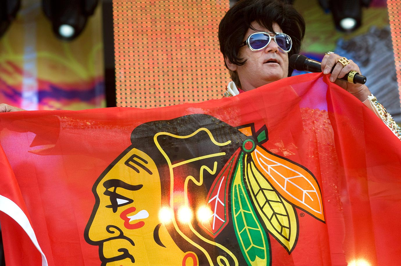 Bill Murray, dressed as Elvis Presley, holds a Chicago Blackhawks banner as he performs onstage at Eric Clapton's Crossroads Guitar Festival on June 26, 2010 at Toyota Park in Bridgeview, Ill.