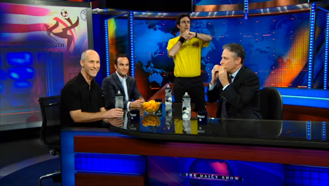 "USA coach Bob Bradley and Landon Donovan appear on ""The Daily Show with Jon Stewart."""