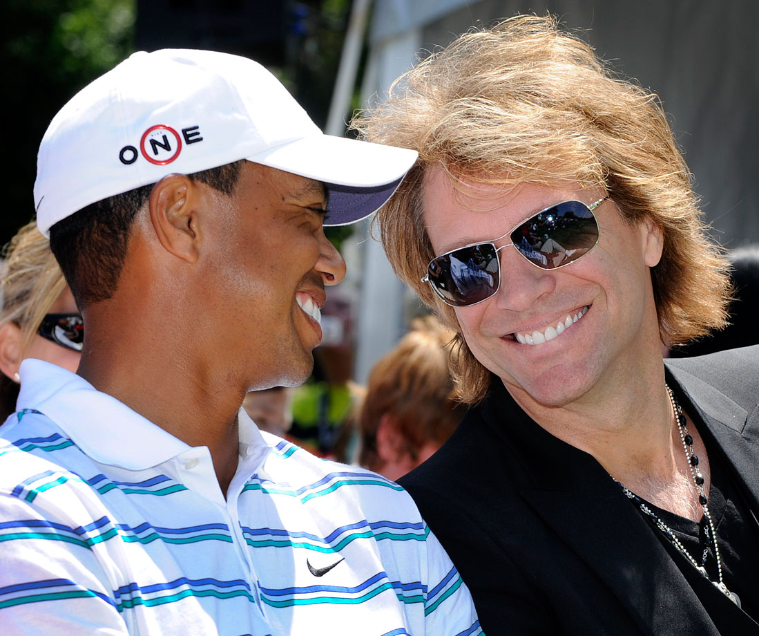 Tiger Woods and Jon Bon Jovi attend the opening ceremonies for the AT&T National at Aronimink Golf Club in Newtown Square, Penn.
