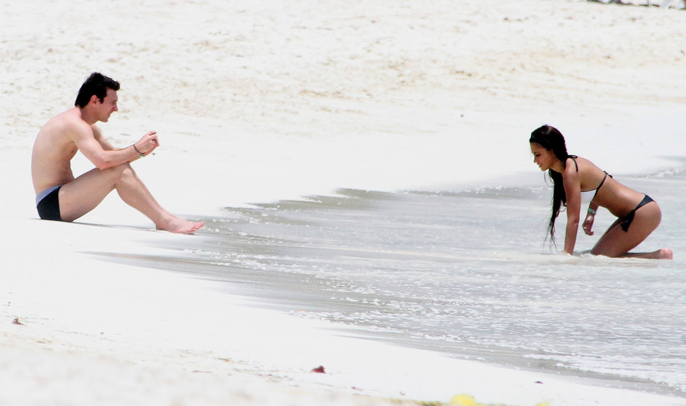 Lionel Messi sits on the beach with girlfriend Antonella Rocuzzo on July 20, 2010 in Cancun, Mexico.