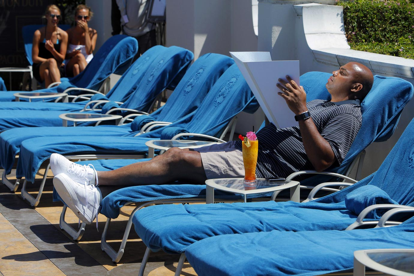 "Charles Barkley tans by the pool in Dana Point, Calif. Barkley competed against Shaquille O'Neal in a round of golf as part of O'Neal's television show, ""Shaq VS."""
