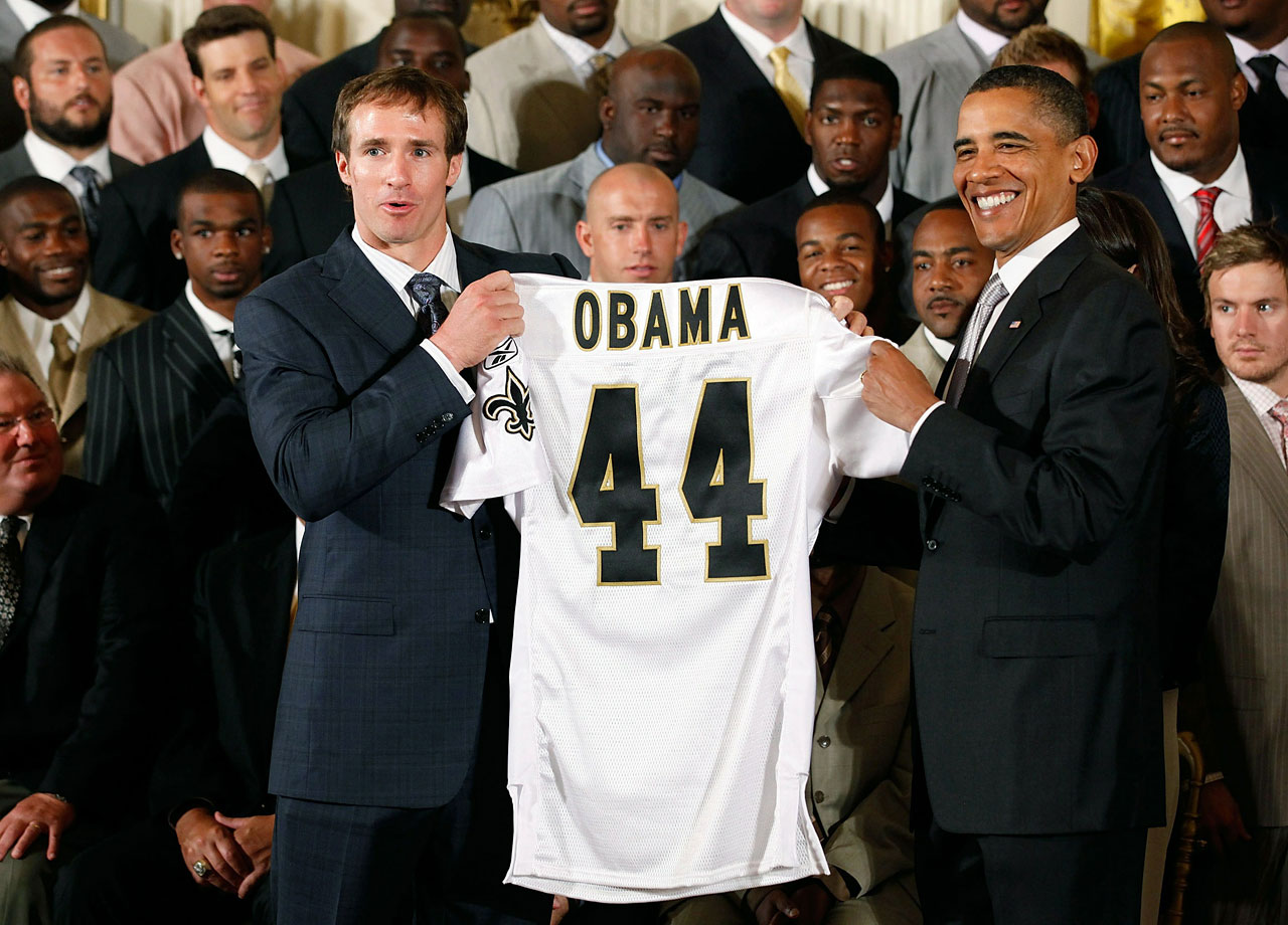 Drew Brees presents U.S. President Barack Obama with a Saints jersey during a reception for the 2010 NFL Super Bowl champions at the White House.