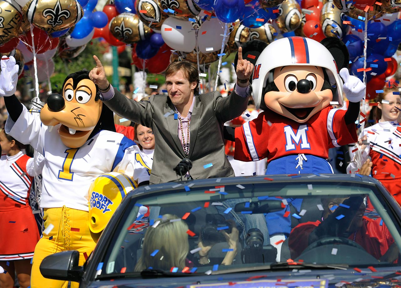 Drew Brees enjoys a ride through Magic Kingdom with friends Goofy and Mickey Mouse following the Saints Super Bowl XLIV triumph. Like many other former Super Bowl champs, Brees punctuated his title with a celebratory trip to Disney World.