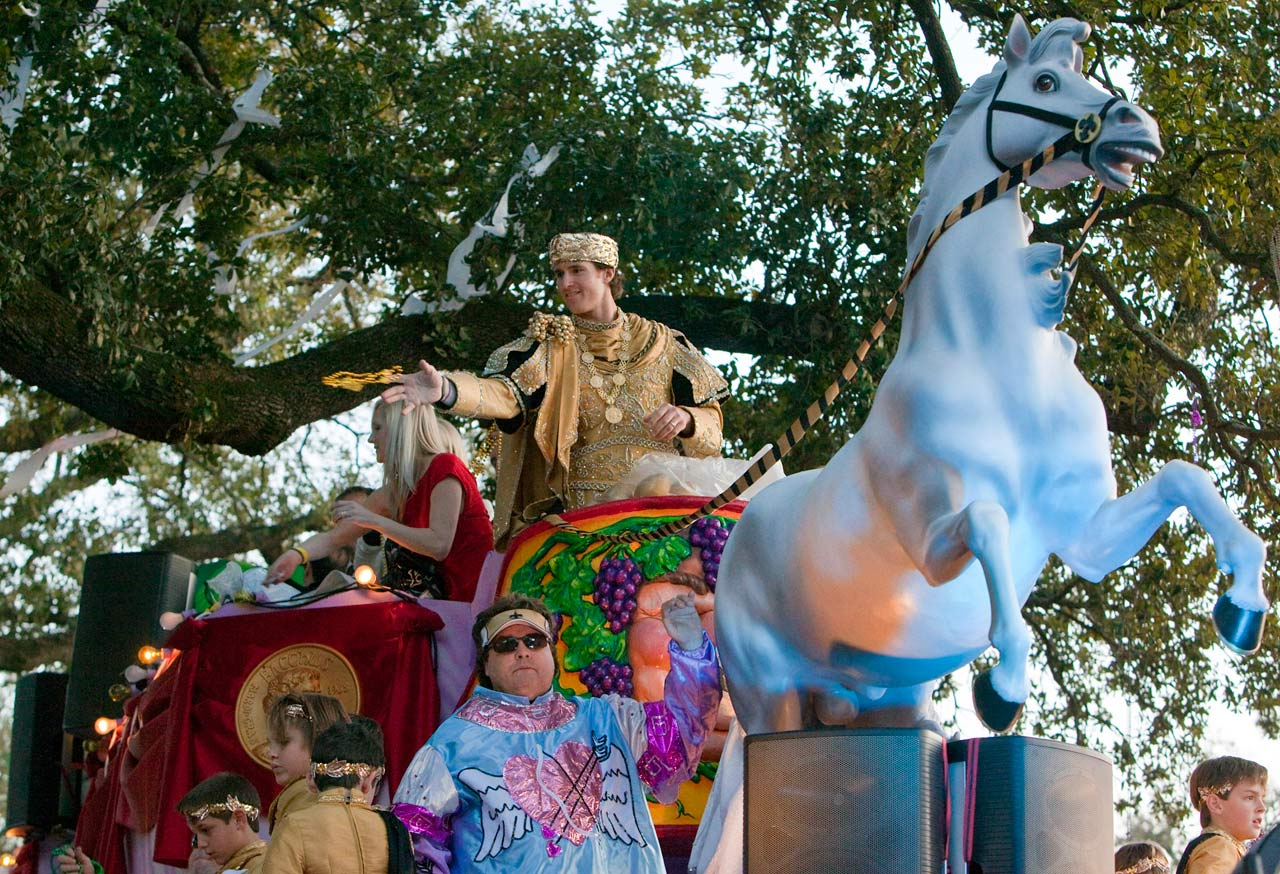 Drew Brees throws beads, footballs and doubloons as he glides down the New Orleans streets as king of the Maris Gras parade.