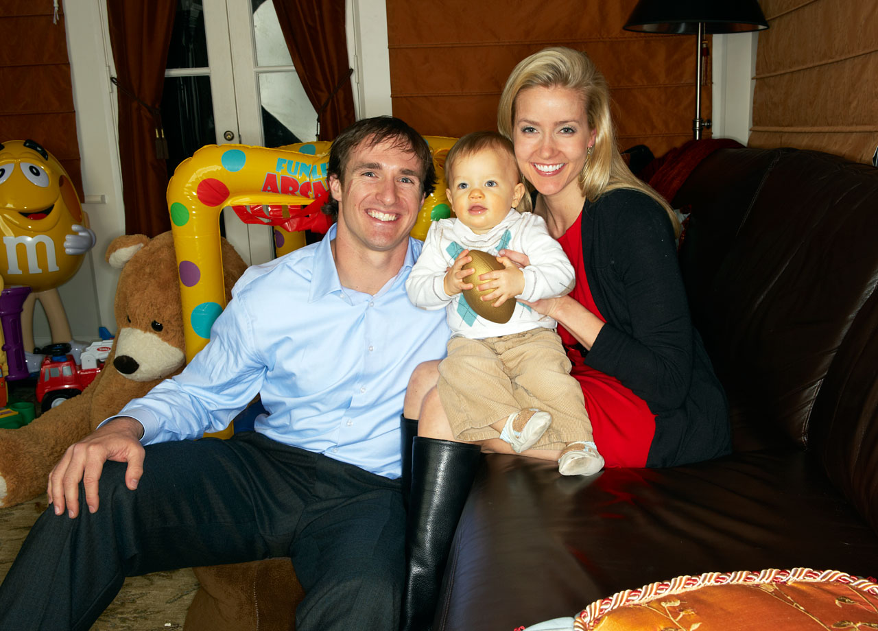 Drew Brees and Brittany pose with their first child, Baylen, at their home in New Orleans.