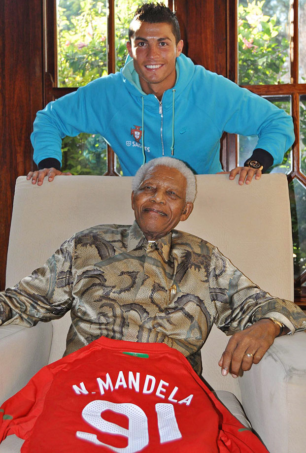 Portugal's team captain Cristiano Ronaldo poses for a photo with Mandela at his residence in Johannesburg.