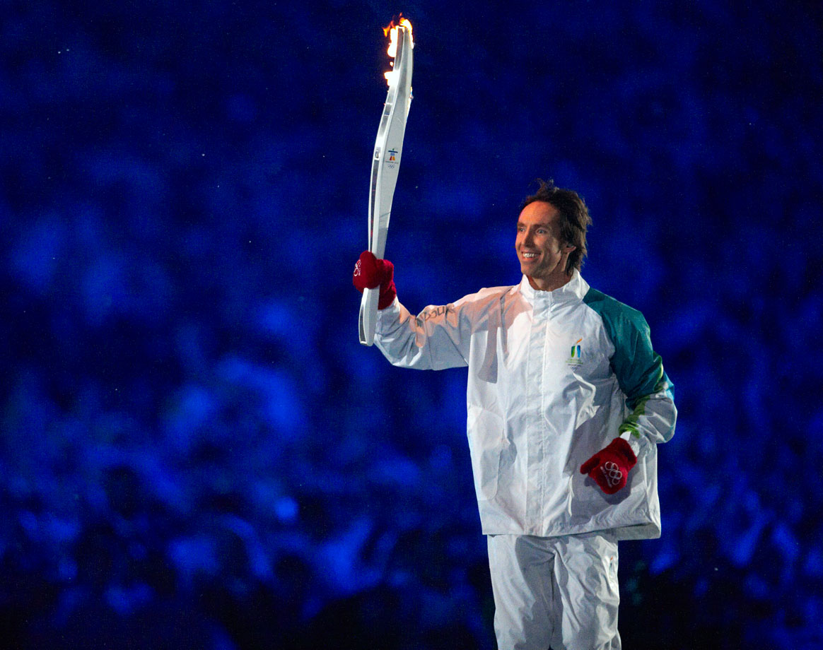 The first NBA player ever to carry the Olympic Torch, Nash hoists the flame during the opening ceremonies for the 2010 Vancouver Games. He helped light the cauldron with fellow countrymen Wayne Gretzky, Nancy Greene and Catriona Lemay Doan.