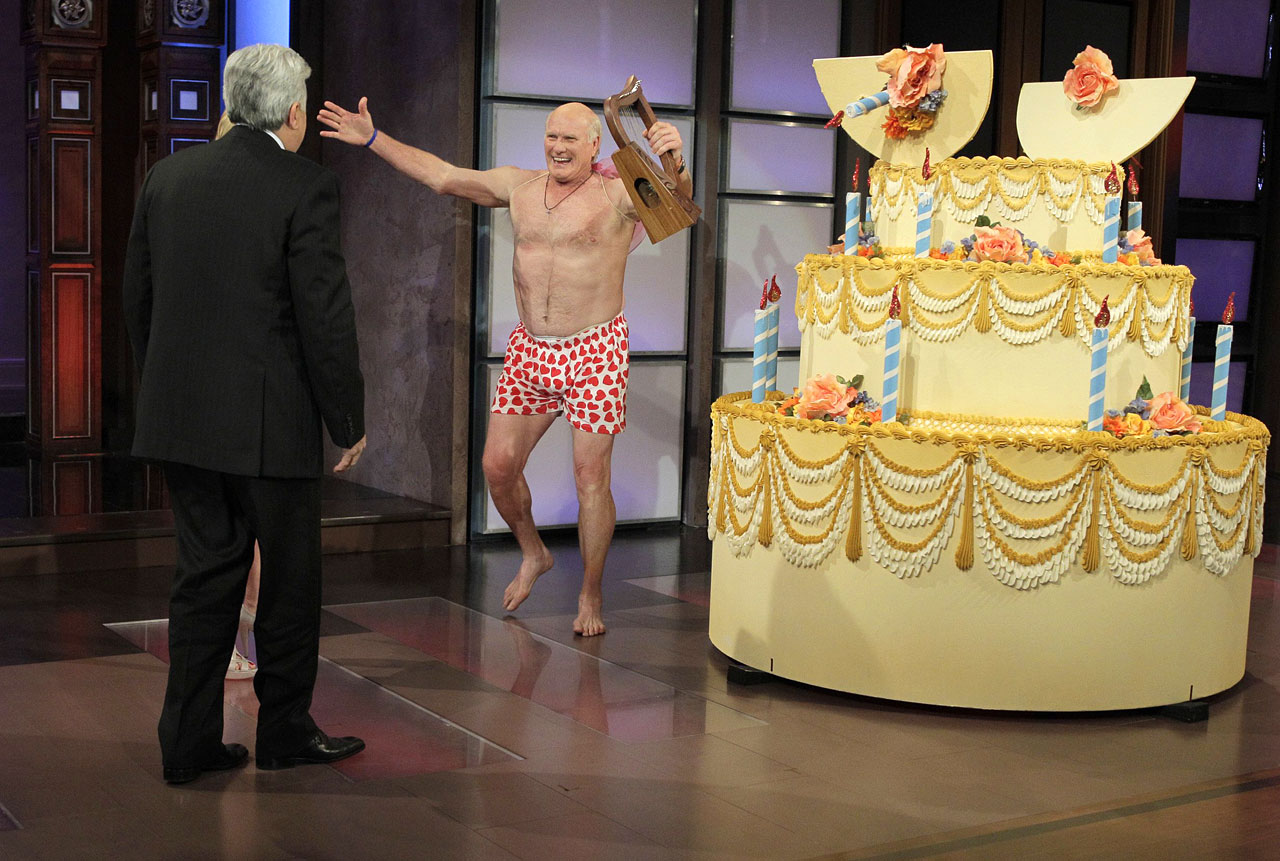 Chelsea Handler surprised Jay Leno on his birthday with a giant cake and a half-naked Terry Bradshaw inside on April 28, 2010.