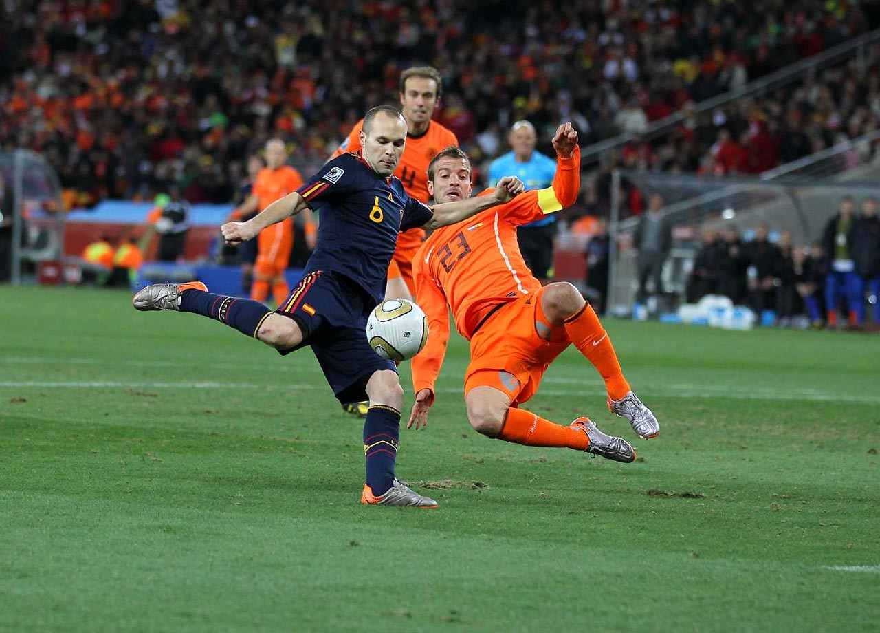 Andres Iniesta of Spain prepares to unleash a shot on goal in the 2010 World Cup final against the Netherlands.  His shot would go in, a 116th minute goal that won Spain's storied national team its first-ever World Cup title, sending an entire nation into hysteria.                                   (Shot with Canon EOS-1D Mark III)
