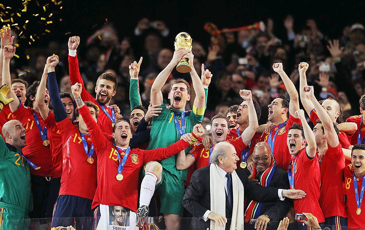 Spanish goalkeeper and captain Iker Casillas raises the World Cup trophy and celebrates with his teammates after Spain defeated the Netherlands, 1-0, in the 2010 World Cup final.                           (Shot with Canon EOS-1D Mark III)