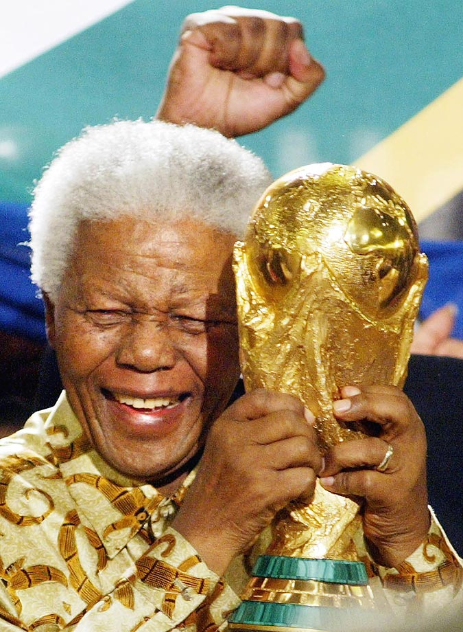 Nelson Mandela lifts the World Cup trophy in 2004 in Zurich, Switzerland after FIFA's executive committee awarded the 2010 World Cup to South Africa.