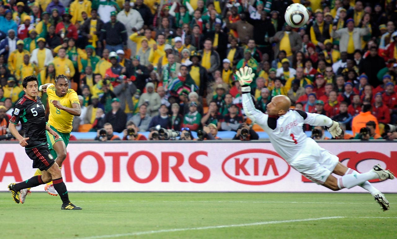 Siphiwe Tshabalala scores the opening goal of the 2010 World Cup for hosts South Africa, sparking raucous celebrations throughout the stadium.