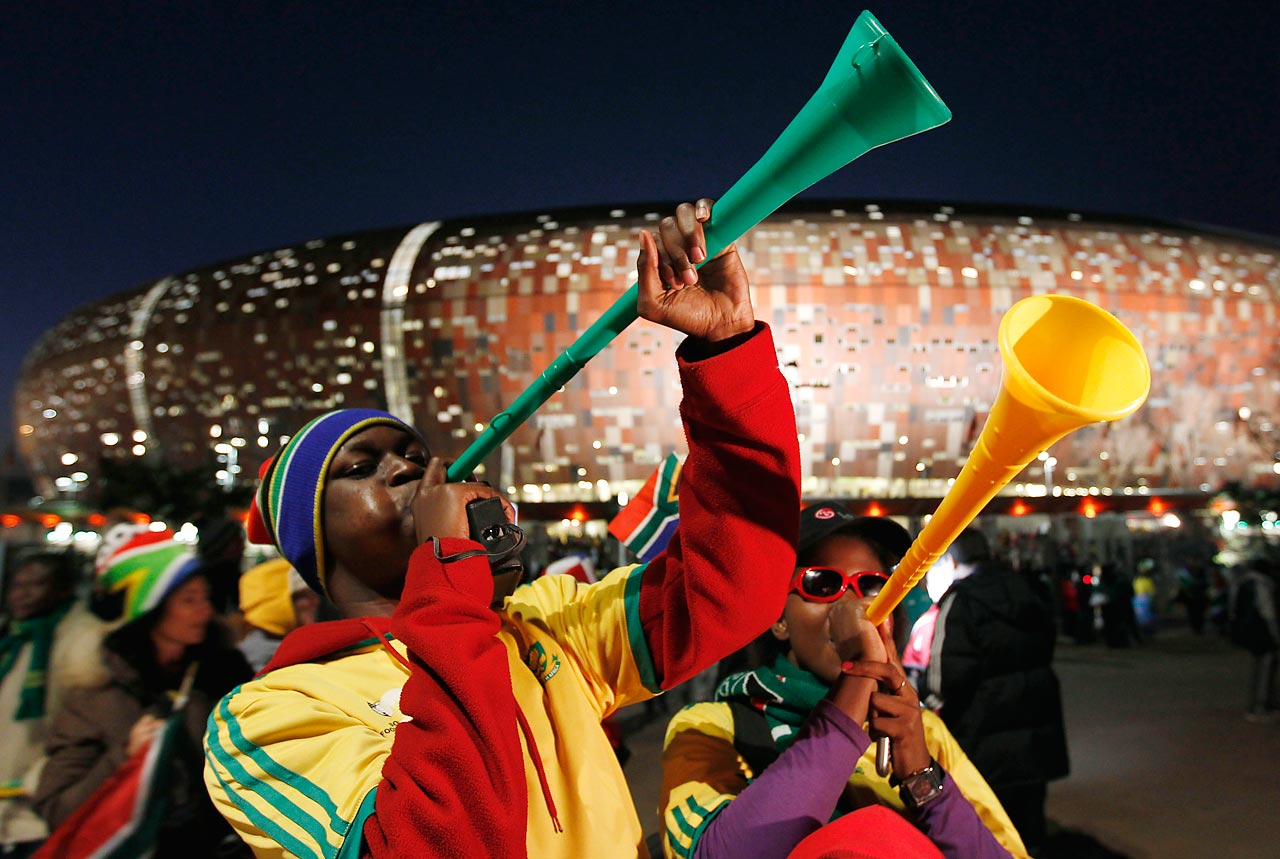 Fans blow vuvuzelas following the opening match of the 2010 World Cup between South Africa and Mexico.