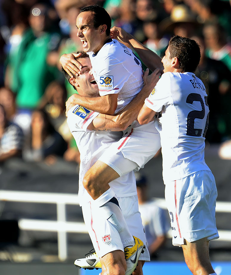 Landon Donovan jumps into the arms of a teammate after scoring against Mexico in the first half of the CONCACAF Gold Cup final in Pasadena, Calif.