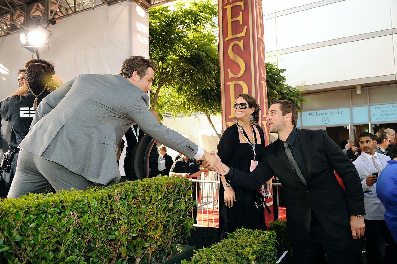 Ryan Reynolds shakes hands with Aaron Rodgers as he arrives for the 2011 ESPY Awards held at the Nokia Theatre L.A. Live on July 13, 2011 in Los Angeles.