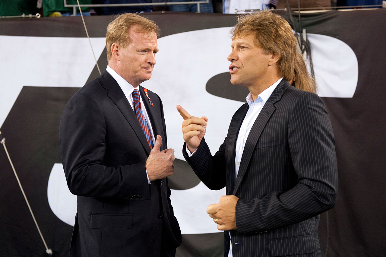 NFL commissioner Roger Goodell chats with Jon Bon Jovi on the sidelines at MetLife Stadium during the game between the New York Jets and the Dallas Cowboys in East Rutherford, NJ.